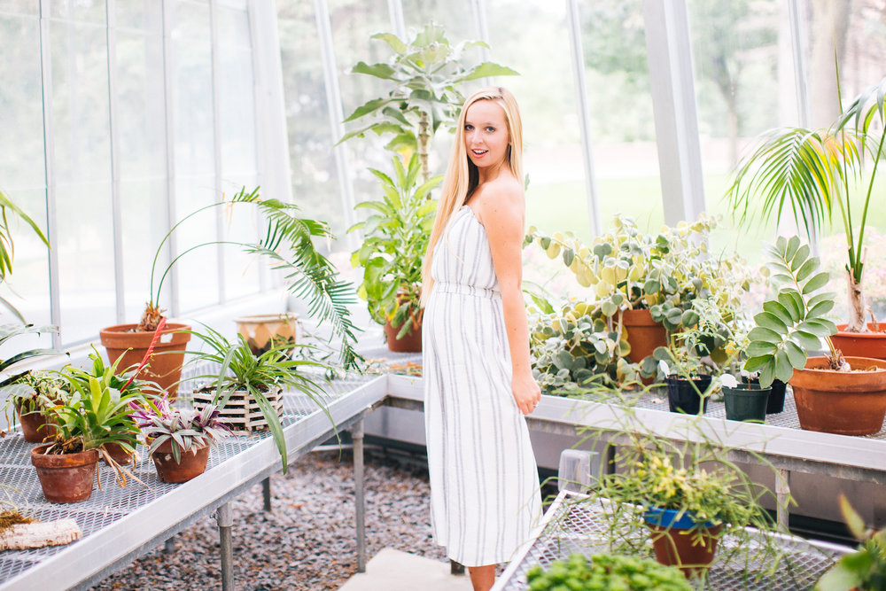 blonde senior photographer shot in a greenhouse