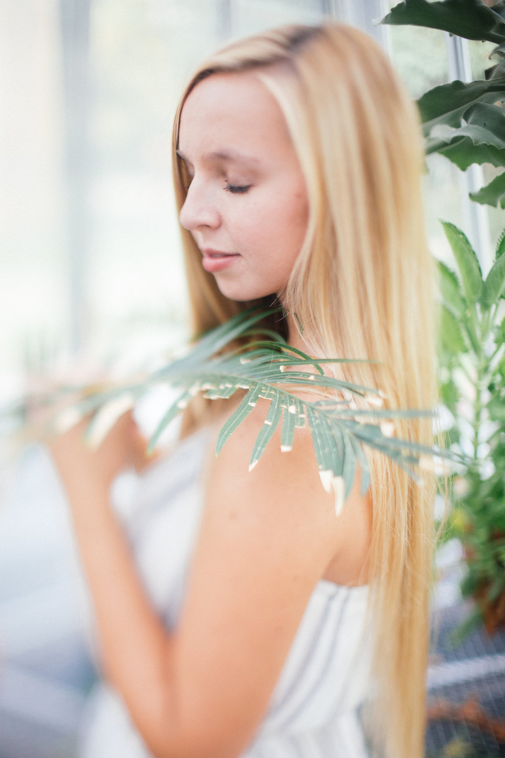 Fine Art Senior Photography in a greenhouse