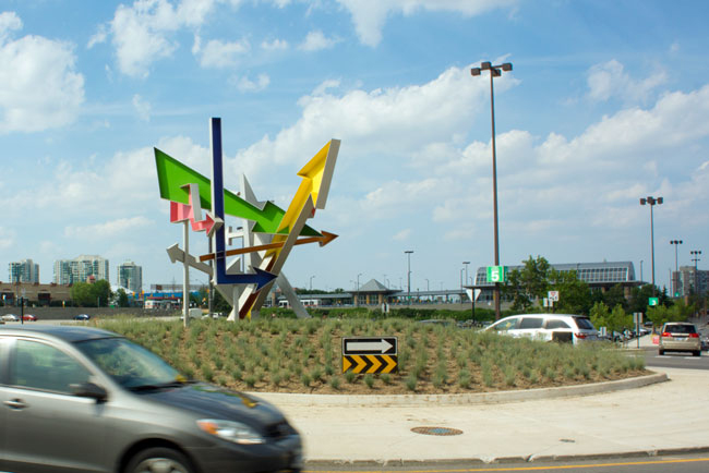 Possibilities  by Michel de Broin, Mississauga, a sculpture of seven coloured arrows inspired by roadside signage from the golden age of the automobile. City of Mississauga Permanent Public Art Collection