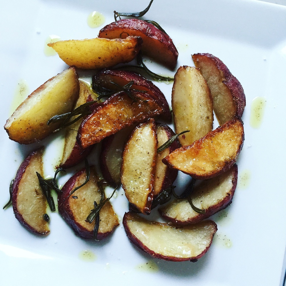 Red potato wedges soaked in sea salt and sesame ginger water, coated with grated Parmesan and garlic powder, then baked in olive oil and fresh rosemary, seasoned with sea salt