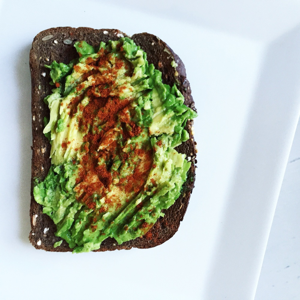 Mashed avocado over toasted German dark bread season with paprika