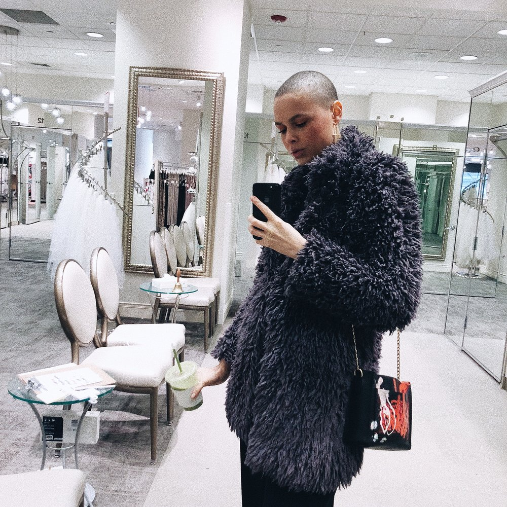 This coat is by an Australian company called Unreal Fur and I think that's the most brilliant shit I've heard for a fashion forward cruelty free line of apparel. I tagged them immediately and am following them on Instagram now. Shoutout, shoutout. Love, love.