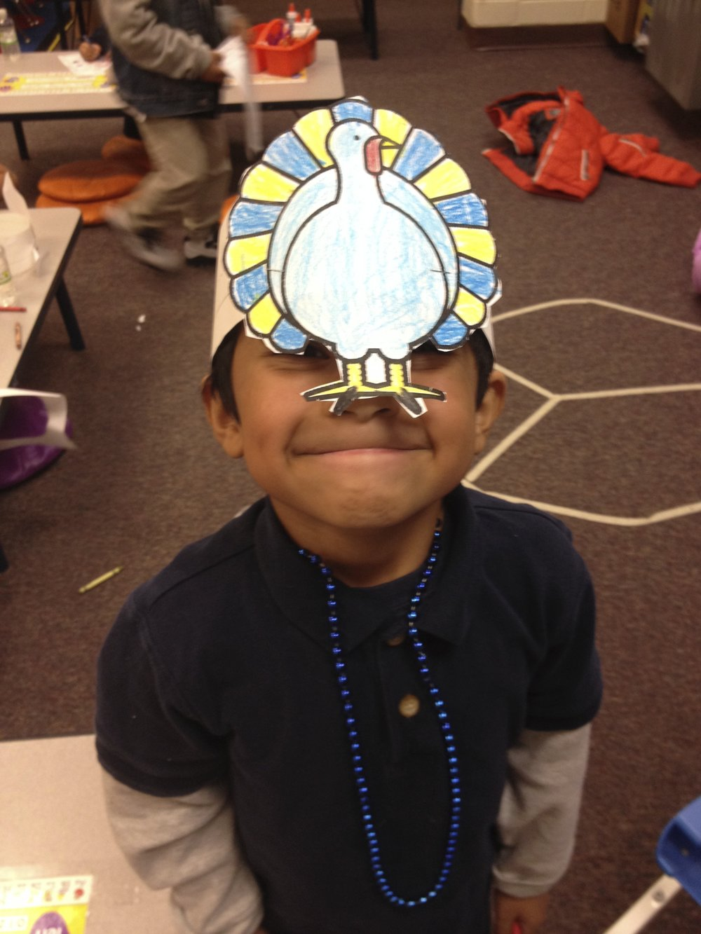 This is just a really cute picture of my student with the Peace Circle in the background.