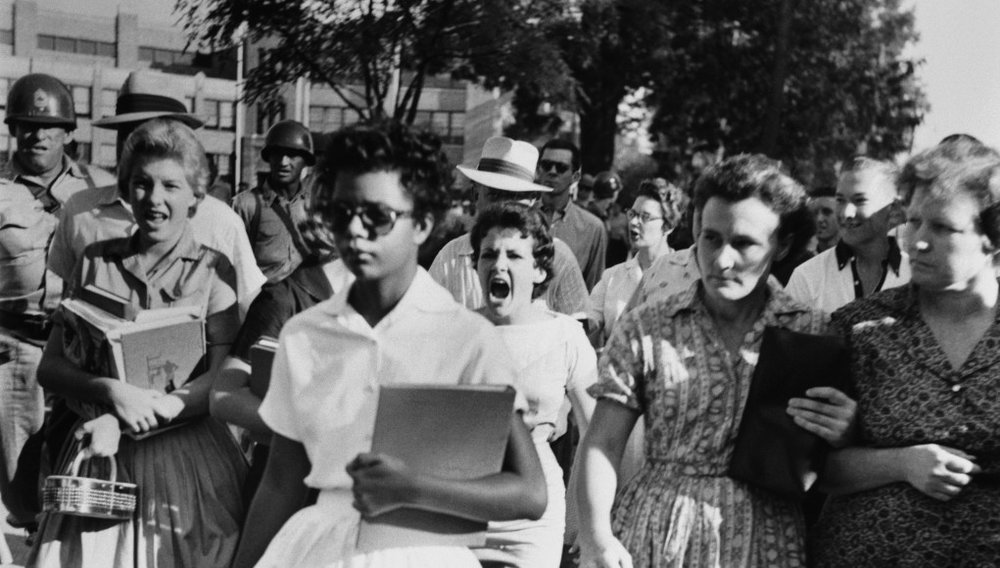 "The famous photo of Elizabeth Eckford, one of the ""Little Rock Nine."" Schools are simultaneously a place where we develop as individuals, and come together as a community. What kind of community do we want to create?"