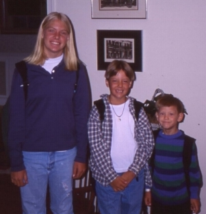 My sister, me, and my brother on the first day of school. 1995. (Yes, that's a yin yang necklace #90s)