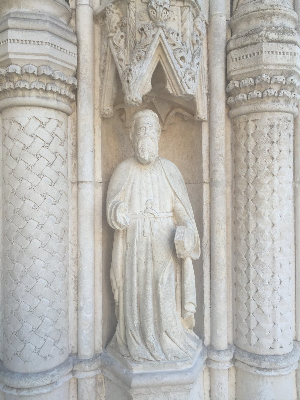 St. James carrying his chisel and the Holy Book. He is elegant, classy, determined,and sort of suave. Kind of like a 14th century Marlboro Man if ever there was one.