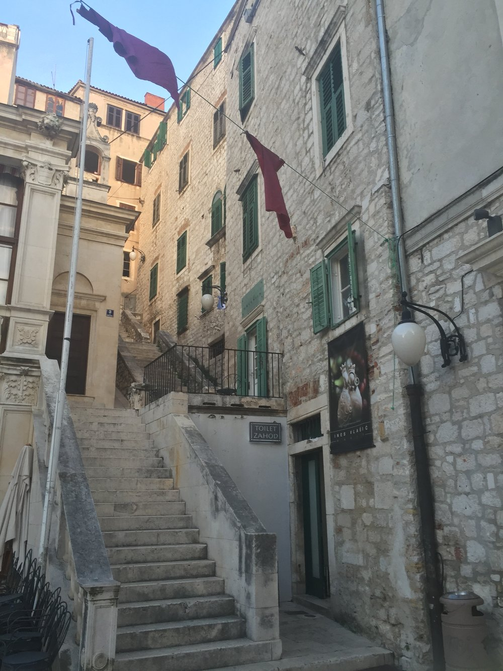 Stairway and atrium leading to the Palazzo Rossini located within walking distance of the city piazza and central square.