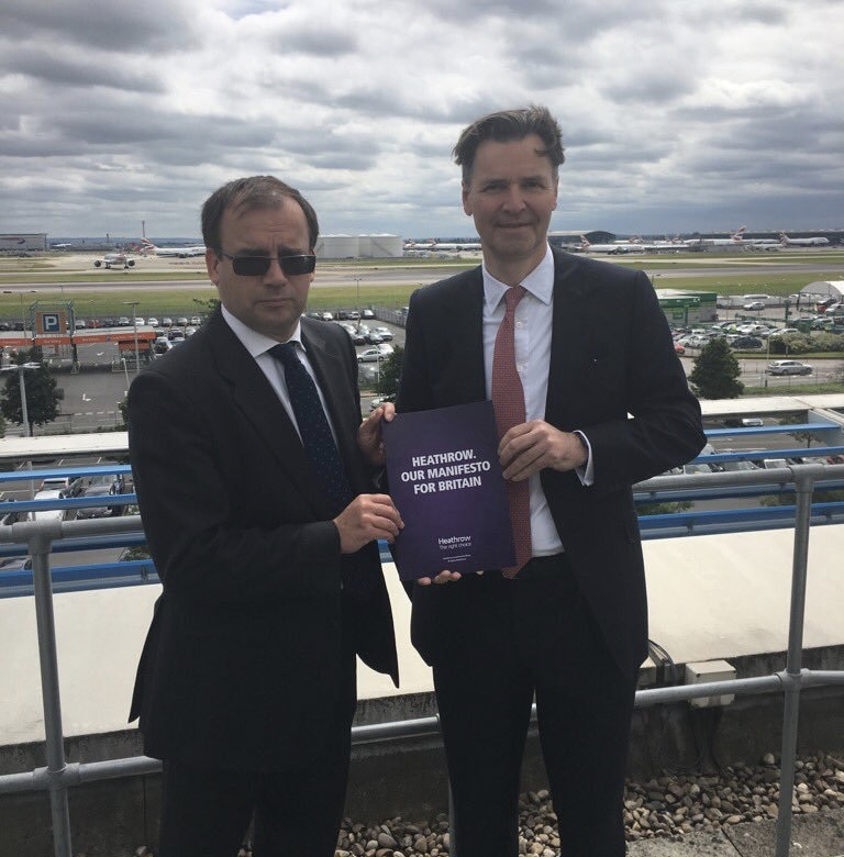 Gareth Thomas with his mate John Holland-Kaye, Heathrow CEO, holding that other manifesto - the one for the foreign airport that wants to destroy homes