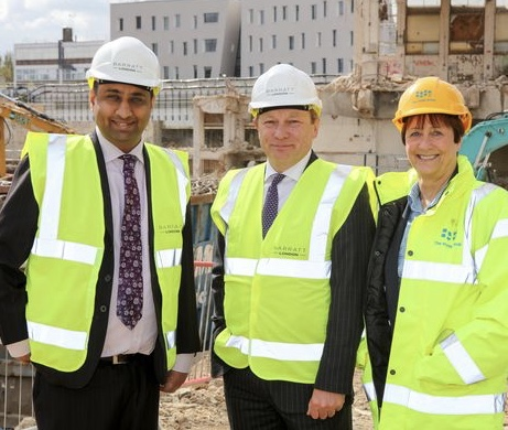 "Cllr Shah in his ""Barratt"" logo hi-viz and hard hat (on left)"