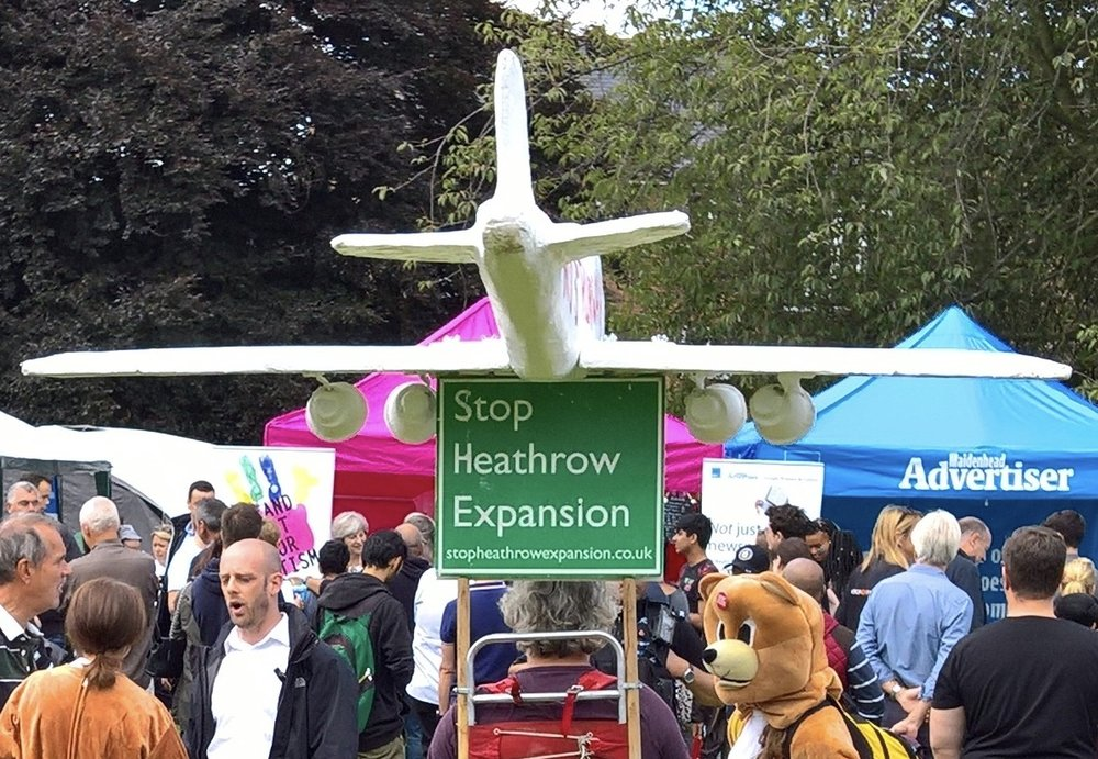Just a normal day at the Maidenhead Festival - man with a plane on his head talks to bemused bear while watching the Prime Minister schmoozing the locals (yes that's her by the pink tent)