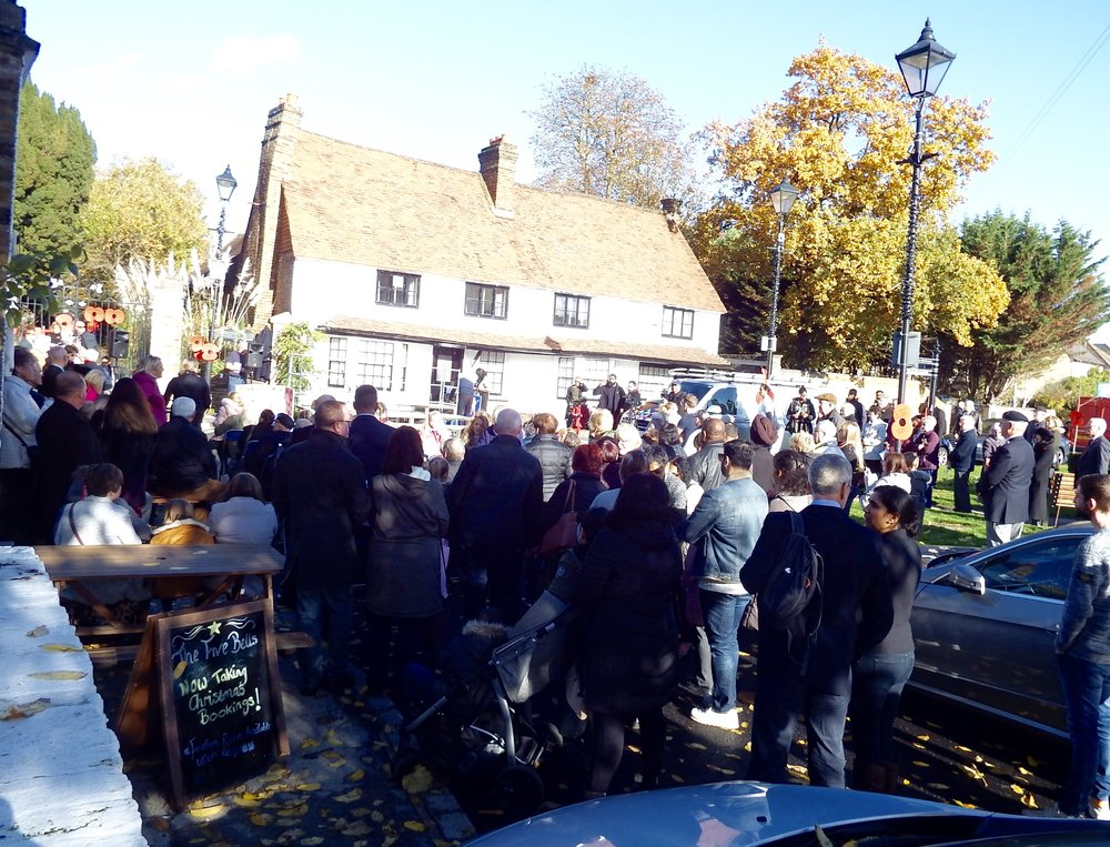As the sun lit the stage it was standing room only on the village green