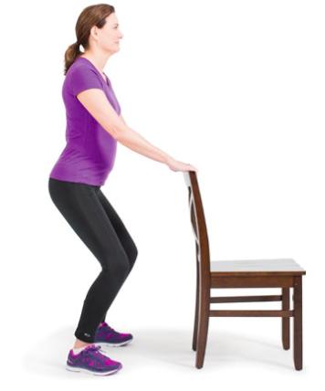 Starting position for mini squat exercise.