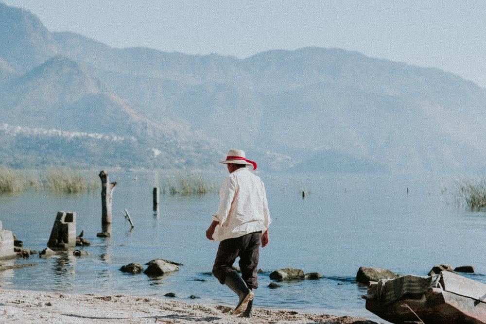 a fisherman walks to the docks in san juan at sunrise