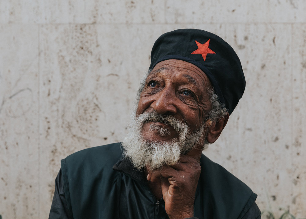 a man on the side of the street shares with me his tales of the revolution in Havana, Cuba