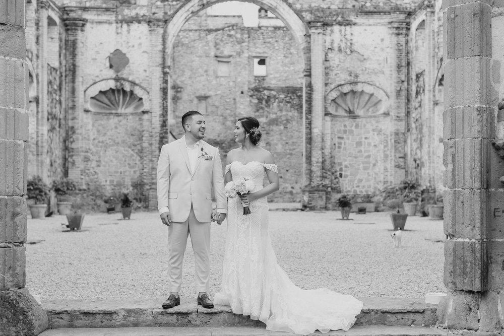Karissa, Israel, and a few streets cats (look carefully, they're everywhere) celebrating as a newlywed couple in the ruins of Casco Viejo Panama.