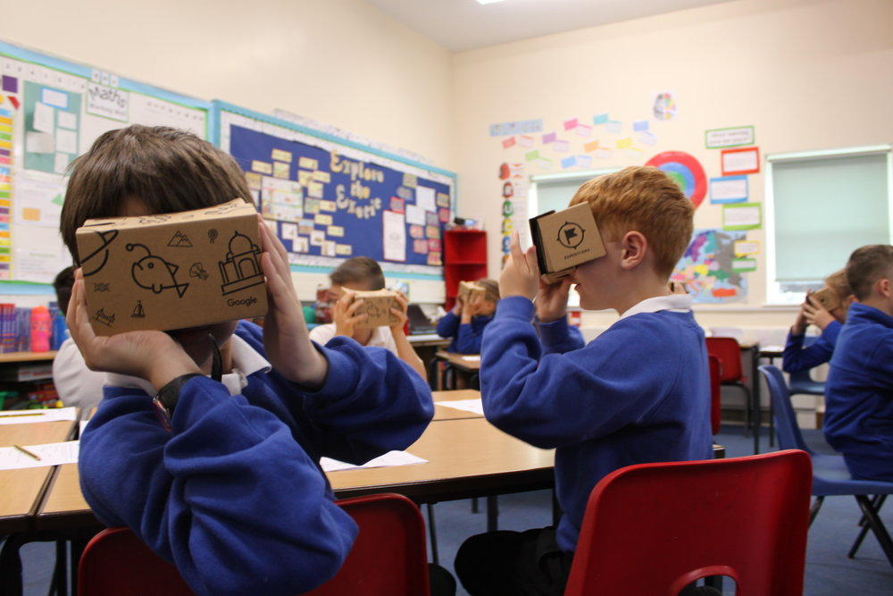 Students viewing a smartphone-driven virtual reality app via Google Cardboard