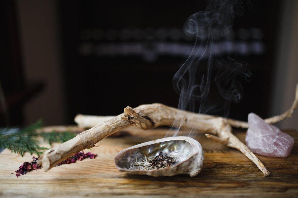Sage burning with devils club and rose quartz