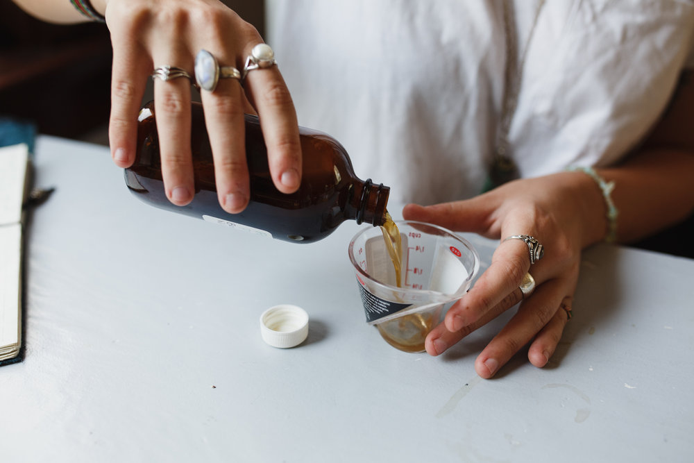 Tincture being poured and measured
