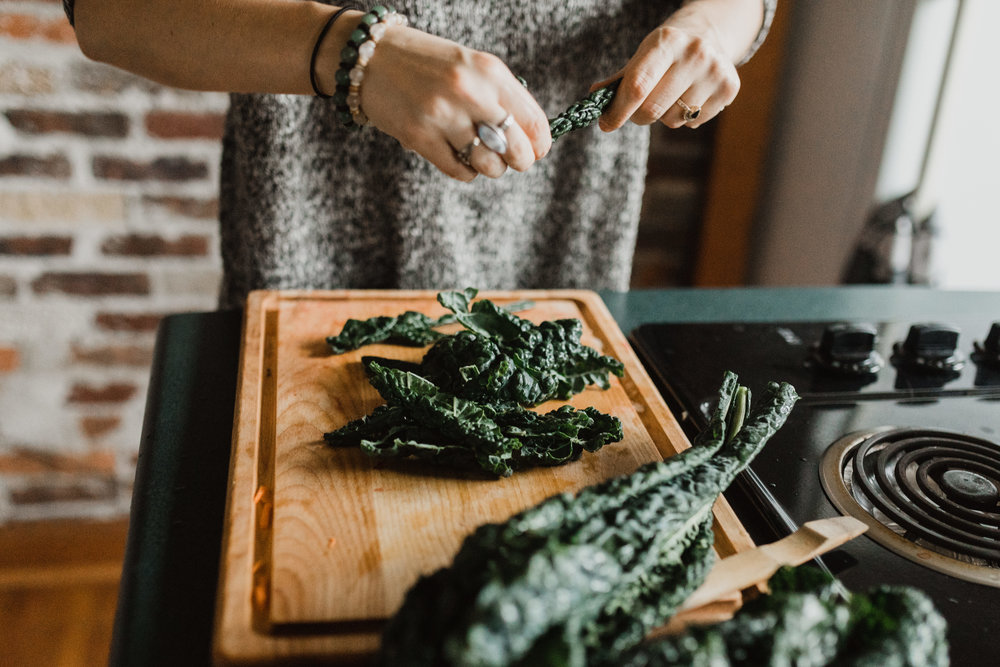 chopping kale in the kitchen