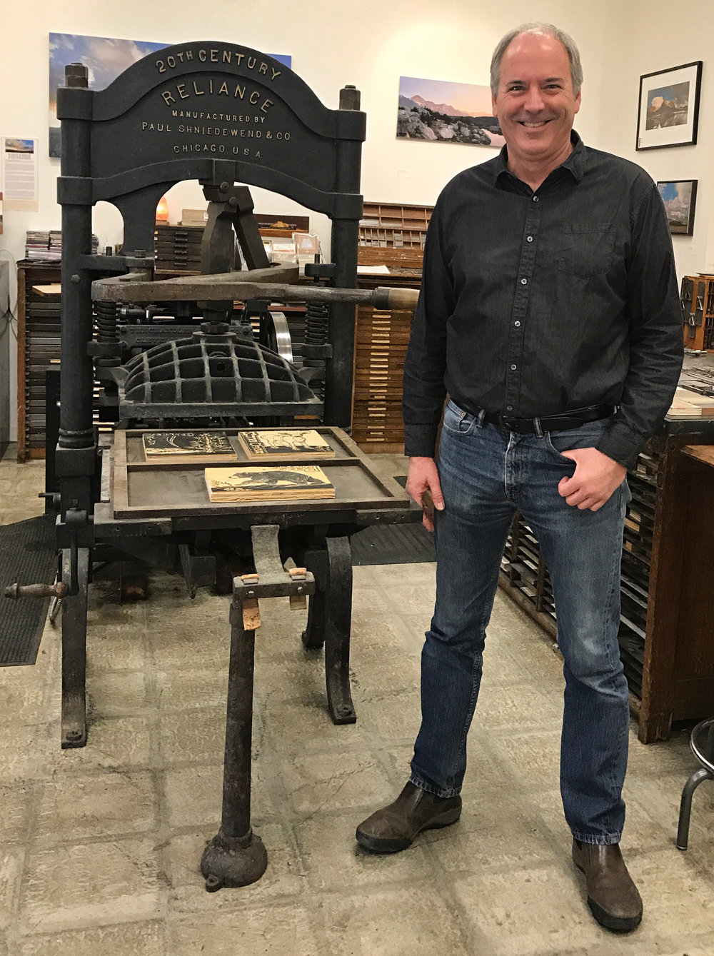 Bruce Licher with the Reliance proofing press 2, photo by Marcy Watton.jpg