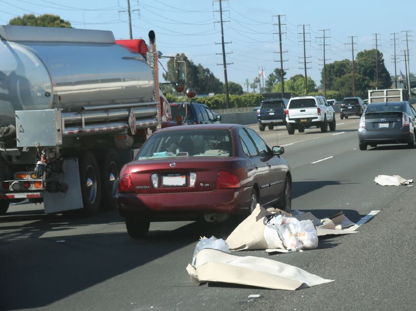 A vehicle moves towards a tanker truck to avoid debris in a lane on State Route 55 near Interstate 5 in Orange County. Photo courtesy Caltrans