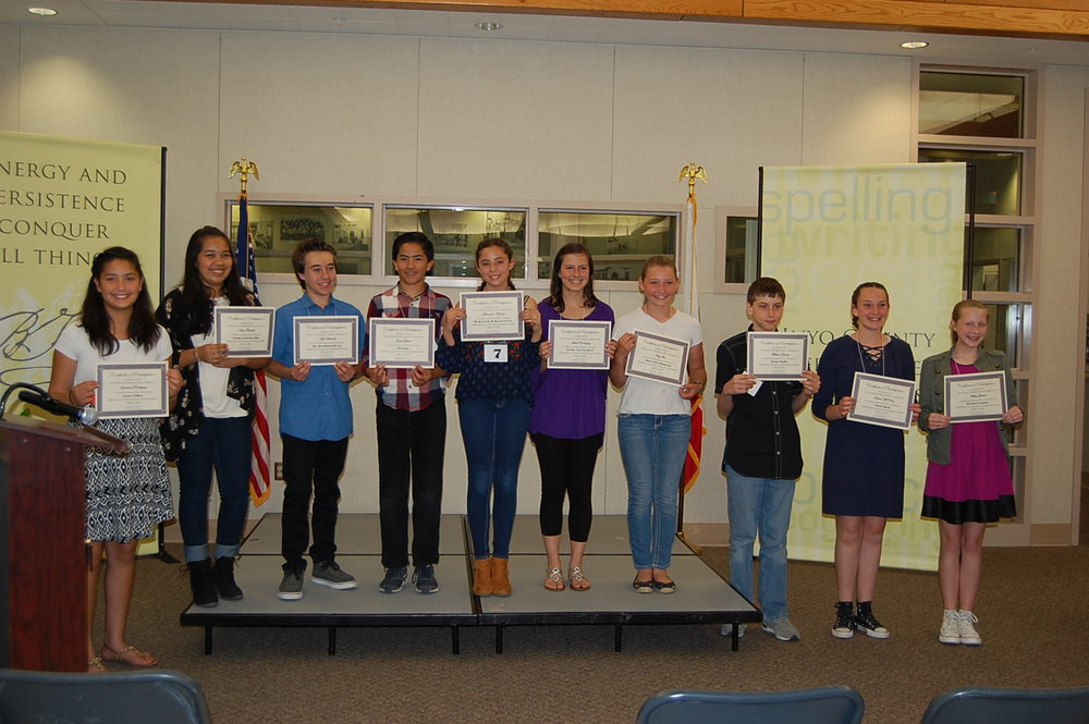 Speech Contest contestants show off their certificates.