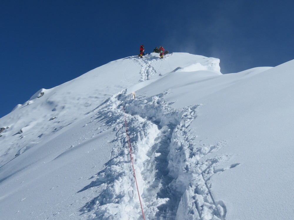 Climbers at the summit of Everest