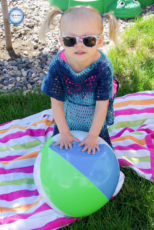 The Ocean Waves Cover Up is designed to have solid stitching at the shoulders to protect that sensitive area from sun and an open-mesh throughout the rest of the piece for fast drying!  It's perfect for a beach day or pool party.  This toddler-sized pattern is extremely easy (beginner friendly!) and used just over 500 yards of yarn. I have tips for you below if you want to increase or decrease the size of the cover up!