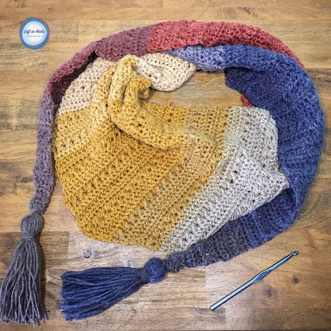 The Crunching Leaves Mod Scarf features all the best warm fall tones with just one cake of Lion Brand Mandala yarn! This trendy triangle scarf will keep you warm all fall and winter long. Read more for the free crochet pattern.