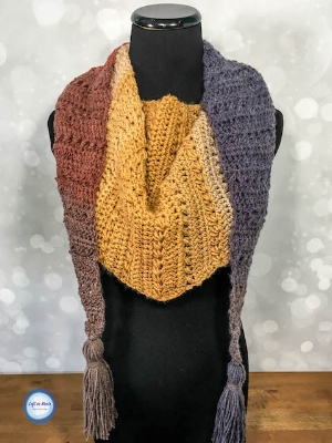 The  Crunching Leaves Mod Scarf  was my first time playing with the lovely Lion Brand Mandala yarn, and I was so happy with the results!  I really love all the color combos available with Mandala, so even if these fall tones aren't what you want for winter you have plenty of other options for this modern triangle scarf
