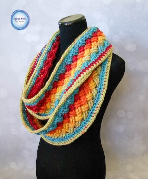 "I have used the Celtic Weave Stitch in several patterns, but your favorite for this year was the ""one skein"" or rather one cake  Lucky Celtic Infinity Scarf .  This pattern uses one cake of Caron Cakes yarn and shows off the colors beautifully! I even have a (left handed) video tutorial to help you out with the Celtic weave stitch :)  I'm going to be working on more left AND right handed video tutorials in the future!"
