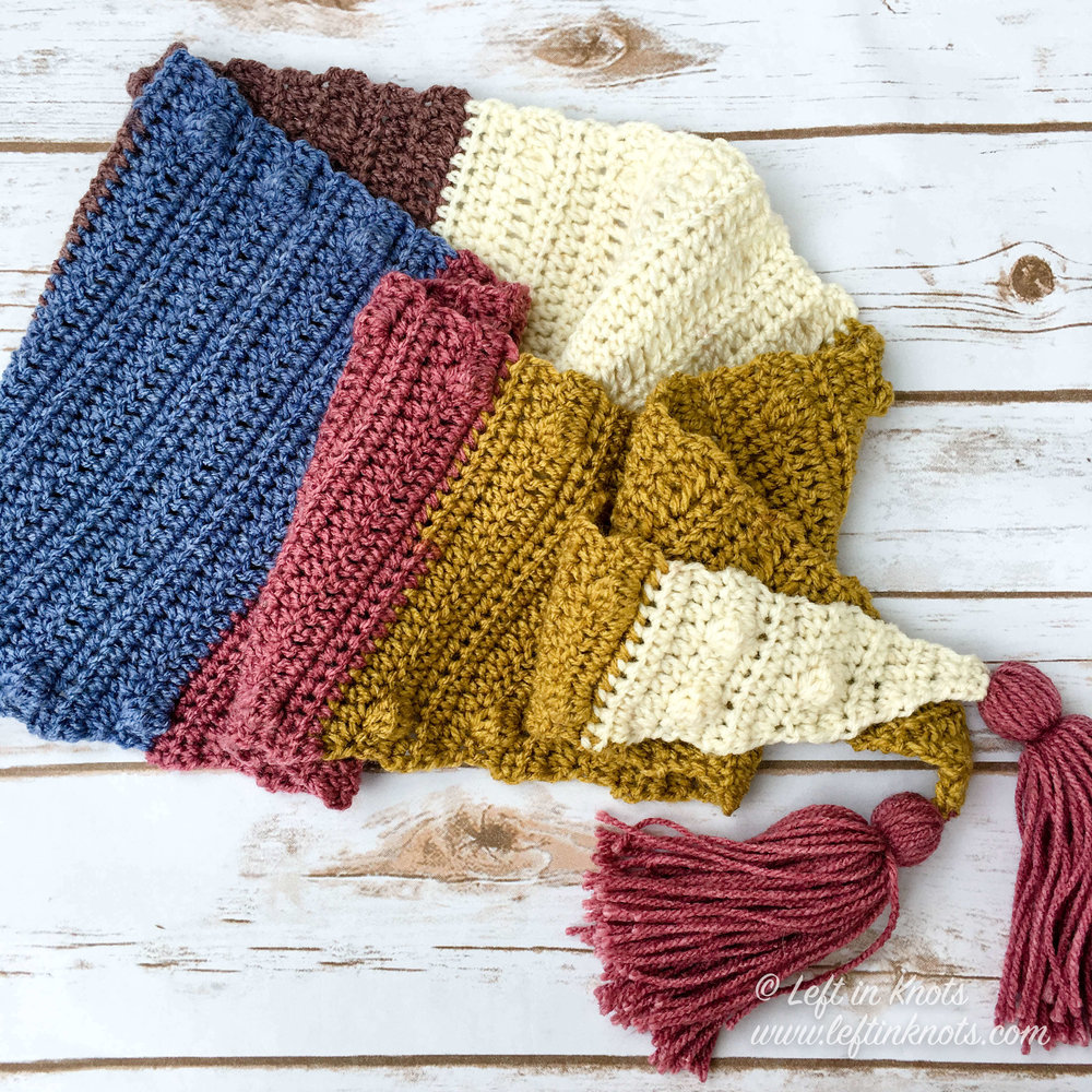 This simple mod scarf is a modern triangle shaped scarf that is outlined in bobbles and adorned with tassels. Made with Caron Cakes yarn (or your favorite worsted weight yarn), it is a one skein project and perfect for transitioning into your fall wardrobe. Enjoy my newest free crochet pattern - the Silhouette Mod Scarf.