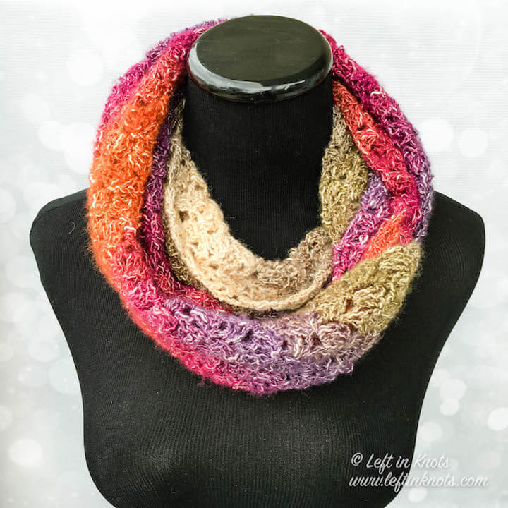 Use just one skein of Lion Brand Shawl in a Ball or Shawl in a Cake to make this simple C2C infinity scarf as a lightweight accessory for fall. The Eventide Infinity Scarf is a free crochet pattern on Left in Knots.