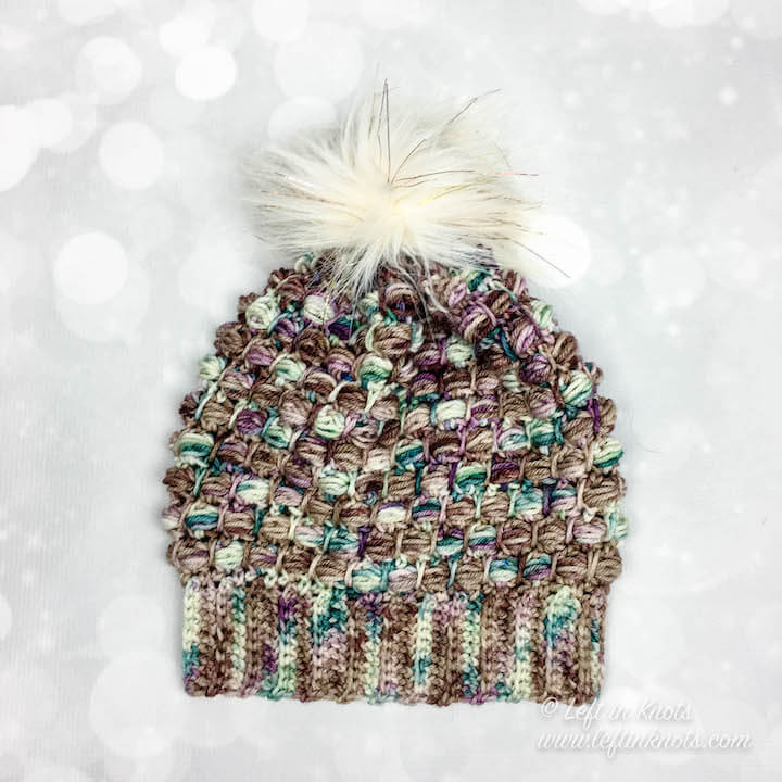 The Fairytale Slouchy Hat is the perfect combination of modern texture and stunning hand-dyed yarn. Top it off with a fluffy, faux fur pom and you have your new favorite crochet slouch hat! Use just one skein of your favorite hand-dyed yarn from your stash or substitute any light worsted weight yarn from your stash! Find the free crochet pattern here.