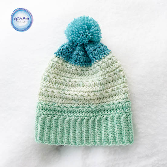 The Snow Drops Messy Bun Hat pattern is part of my popular Snow Drops pattern collection, and it uses my absolute favorite colorway of Caron Cakes yarn. Of course you can use any worsted weight yarn of your choice - that stitch definition of the star stitch would look stunning in any color! Keep reading for the free crochet pattern.