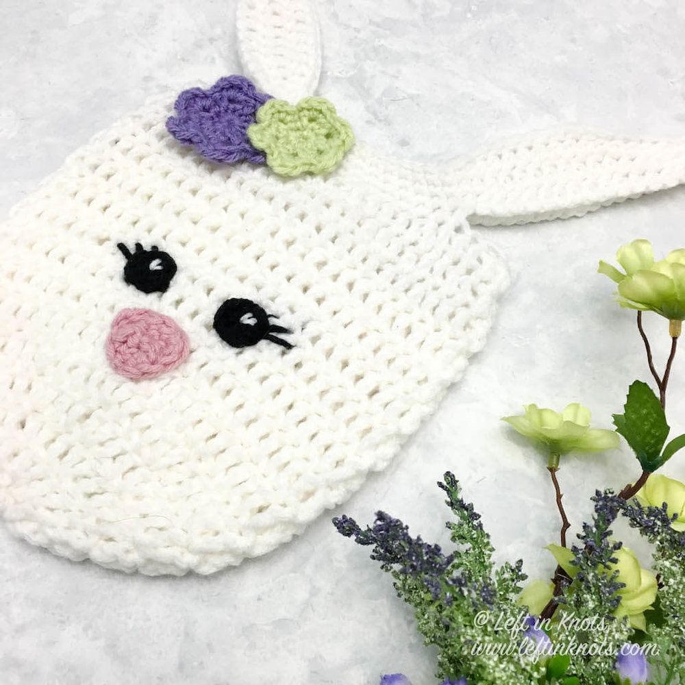 Use this easy free crochet pattern to make an adorable mini bunny bag perfect for Easter! This little Easter Bunny can be used for Easter egg hunts, as an Easter basket, or even as a sweet spring purse. Find the pattern for the beginner friendly bag and all the embellishments here!