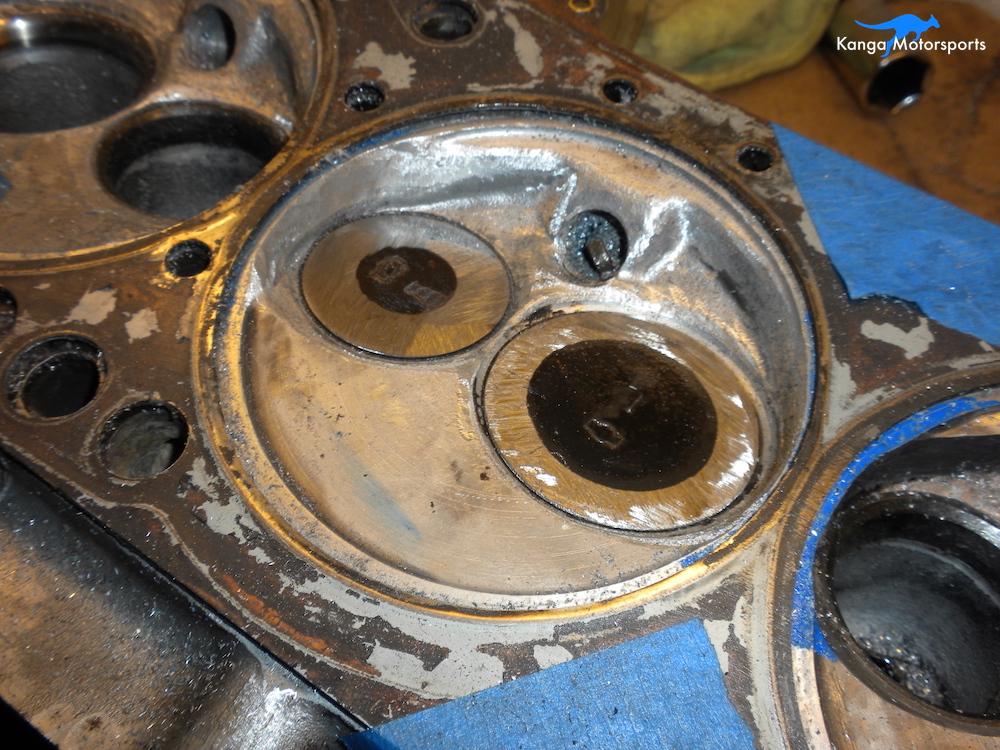 Datsun Cylinder Head Chamber Ground Down Valve.JPG