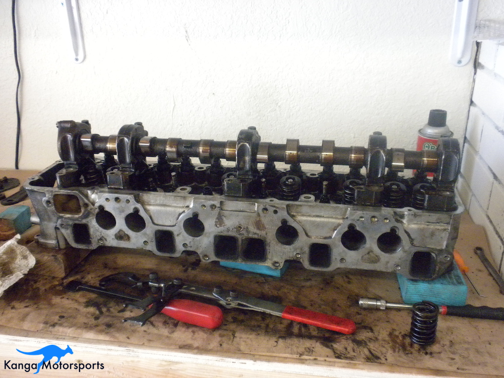 Cleaning the Gasket Surface Datsun Cylinder Head.JPG