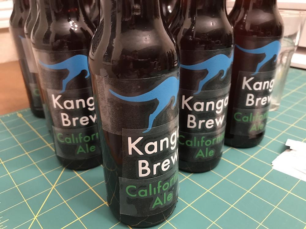 Applying Beer Bottle Decals.JPG
