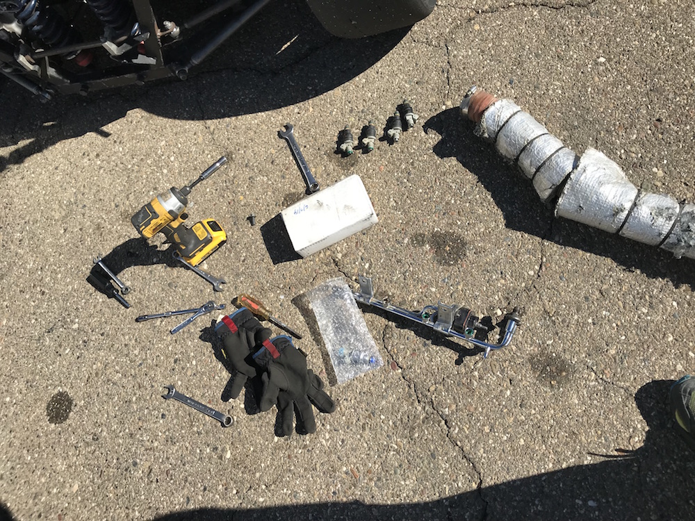 Kanga Motorsports SCCA Spec Racer Ford Thunderhill Removing Fuel Rail.JPG