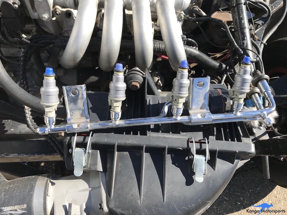 Relacing Injectors Kanga Motorsports SCCA Spec Racer Ford New Injectors On Fuel Rail.JPG