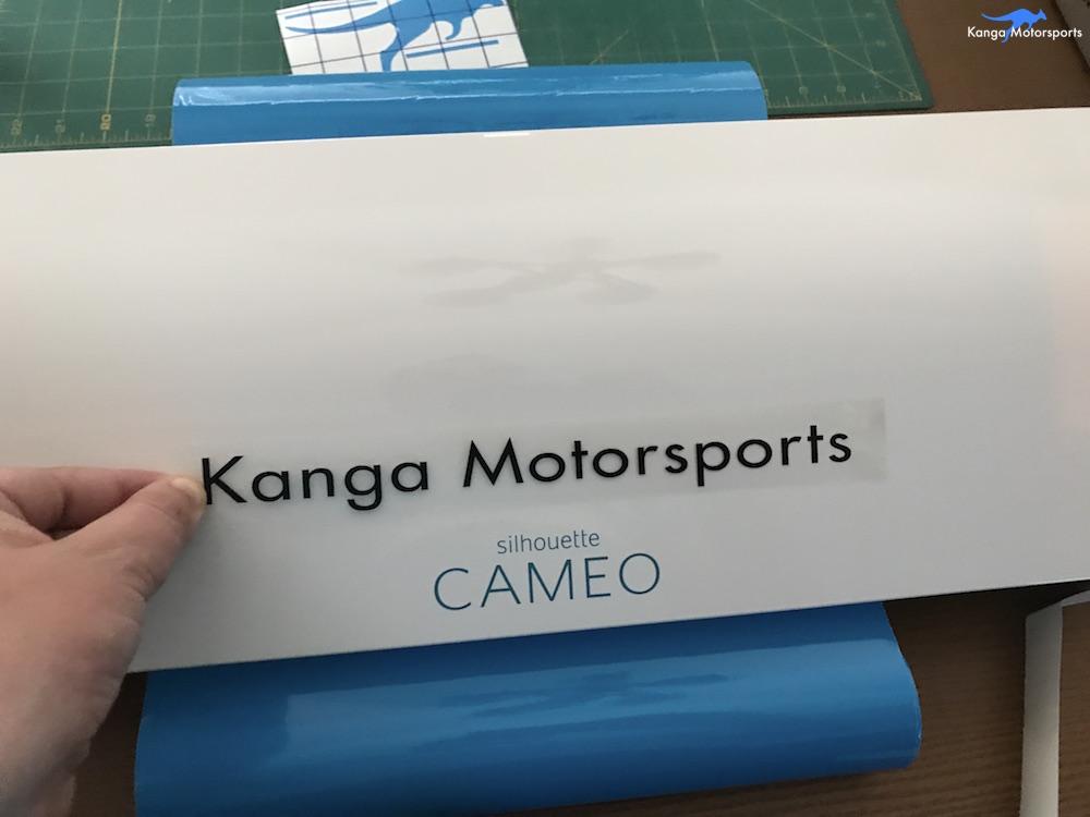 Kanga Motorsports Making Vinyl Placing Letters.JPG