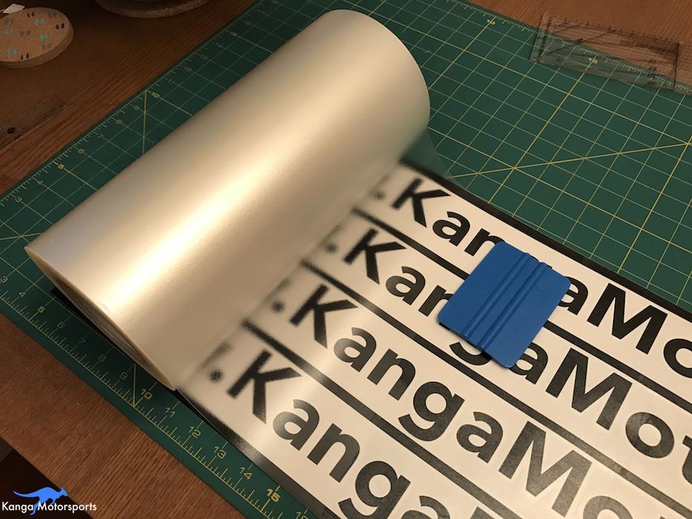 Kanga Motorsports Making Vinyl Placing Transfer Tape.JPG
