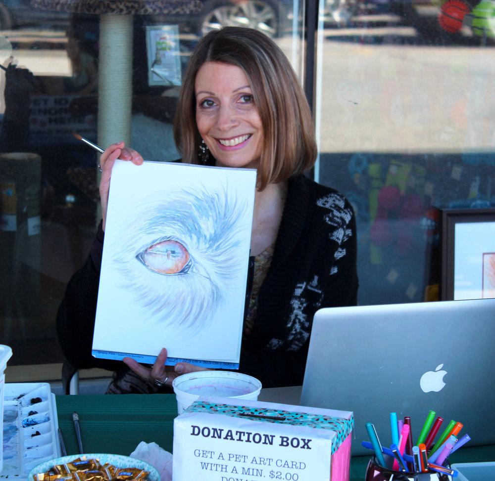 Christa Gampp painting a Dog Eye at Pet Valu in Aurora