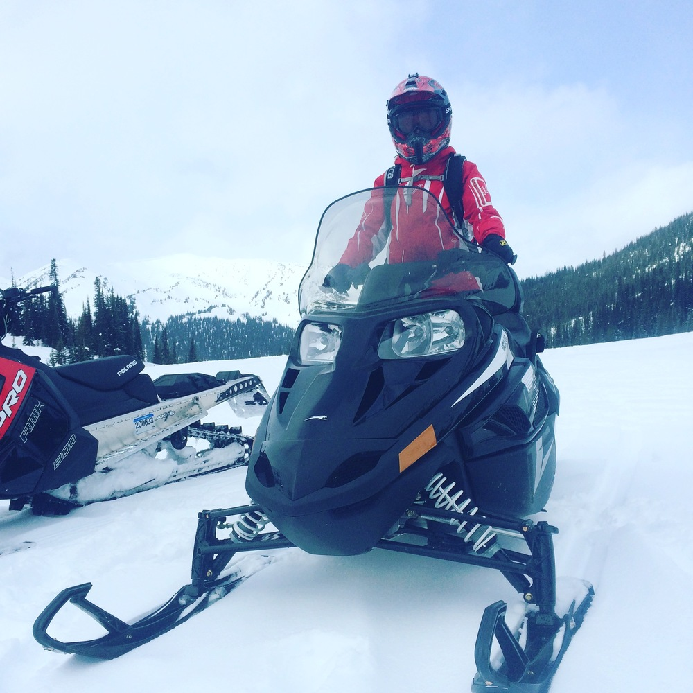 Snowmobiling in Quartz Creek near Golden, BC