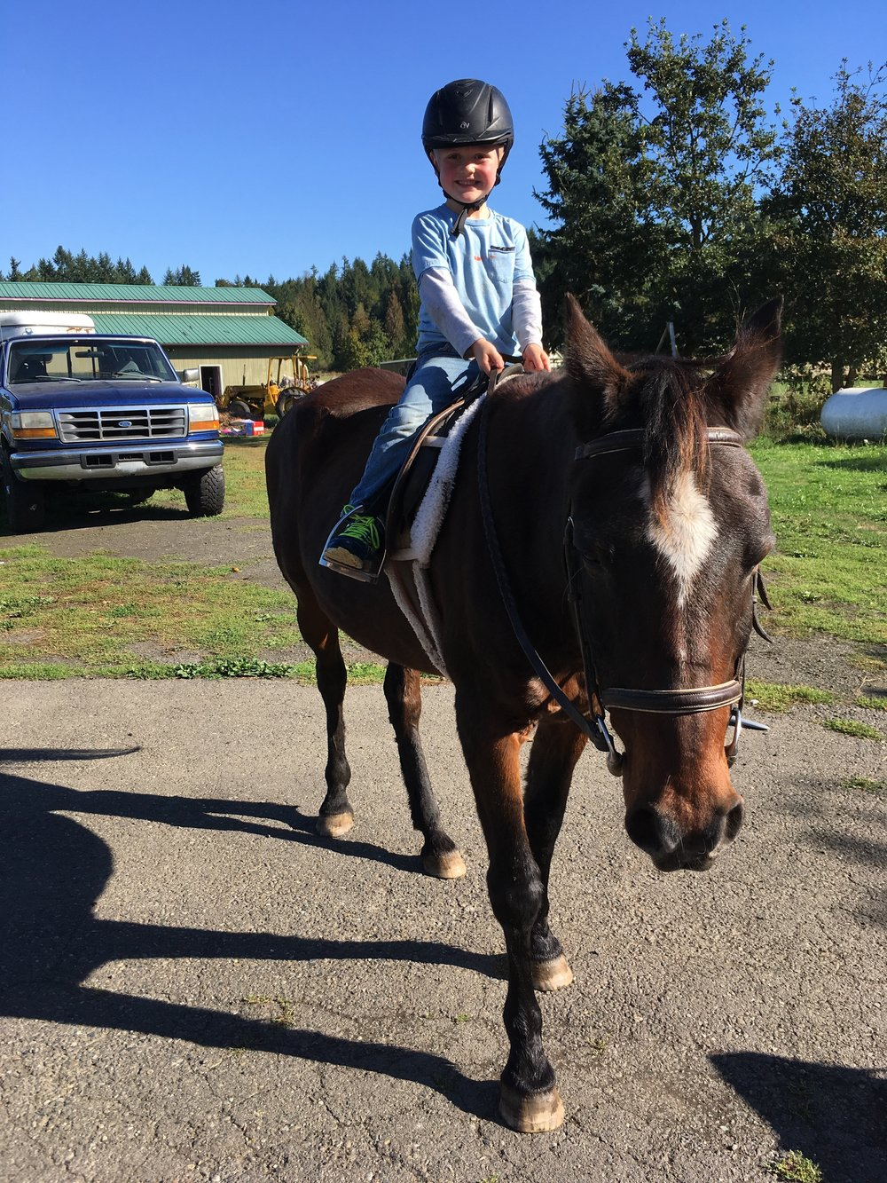 "Judah (5) is all smiles when he gets to take a ride with the ""hors-ees"" as he calls them."