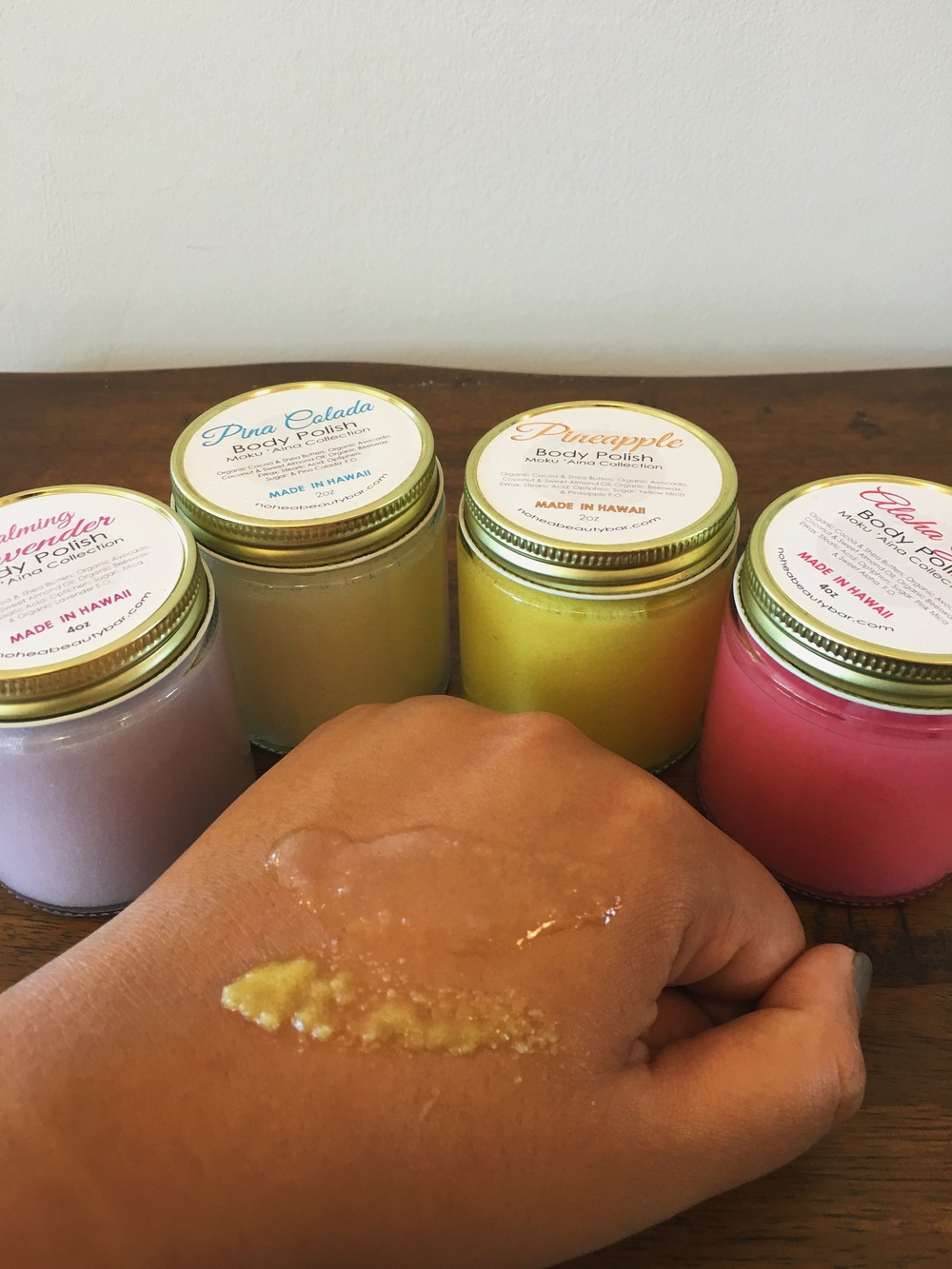 The body polish (sugar scrubs) are amazing. Since it's sugar instead of your typical salt scrub, its more gentle on your body. You can even use it on your face.