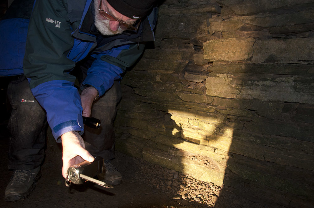ronnie filming direct sunlight inside tomb of the eagles