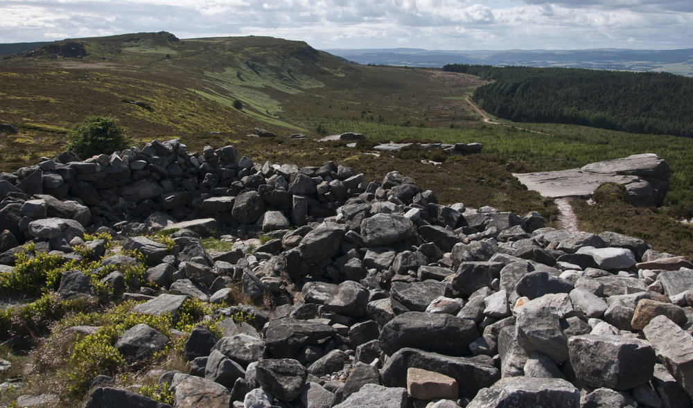 Above: The third Bronze Age cairn on Dove Crag, looking towards the higher summits of the Simonside ridge beyond. This cairn has been disturbed, ...