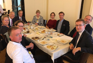 Catholic Poland isn't buying EU's soft despotism, MP Robert Winnicki (right) told us at a Parliament luncheon. Delegation chairman Wolff is at left.